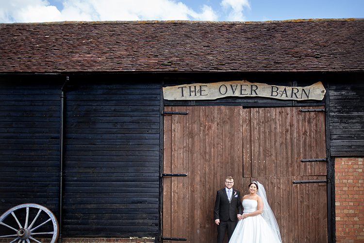 bride and groom at over barn