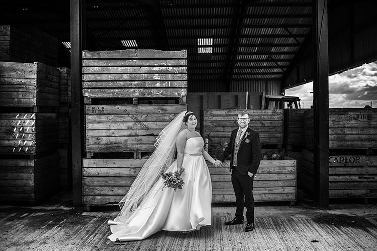 Bride and Groom posing at farm.