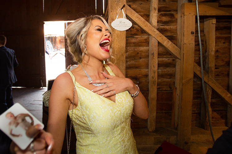 Wedding guest laughing.