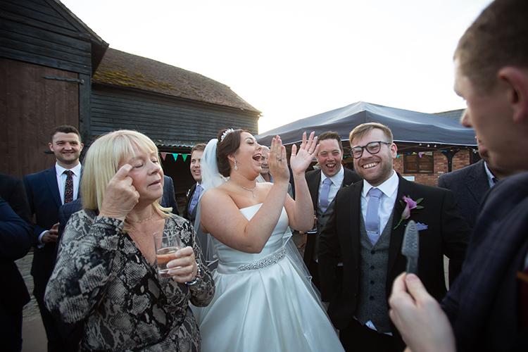 Bride laughing at magician.