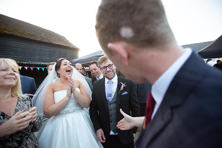 Bride laughing at magician
