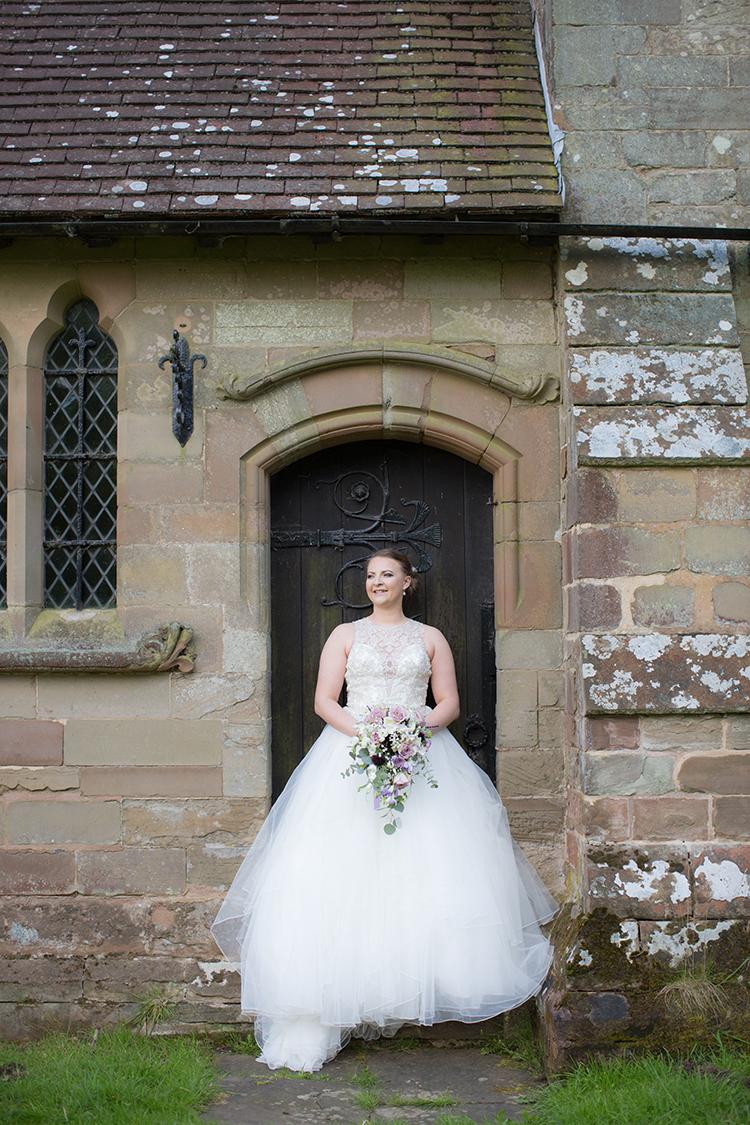 The Bride against the Church door.