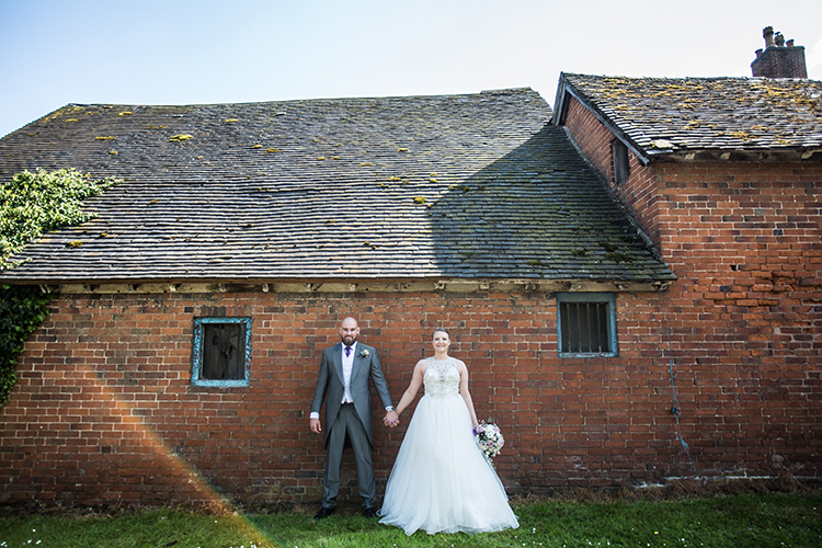 The Brides & Groom outside the farm