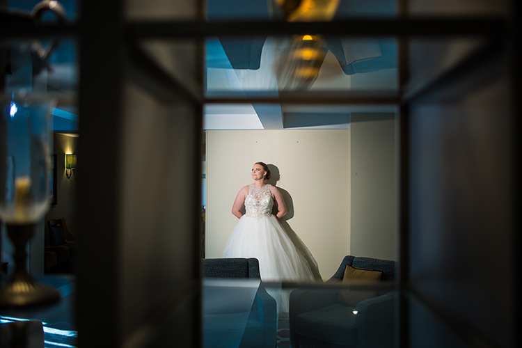The Bride against a wall inside Kings Court Hotel.