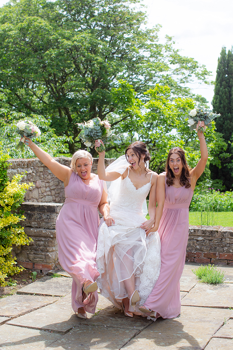 Bride and Bridesmaids having fun.