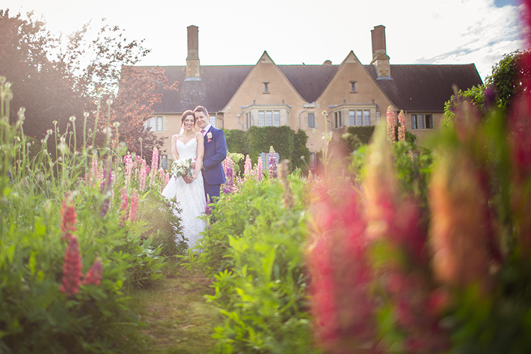 Bride and Groom in herb garden at Mallory Court.