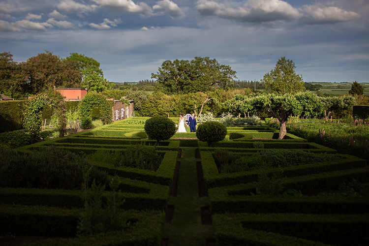 Bride and Groom in Garden.
