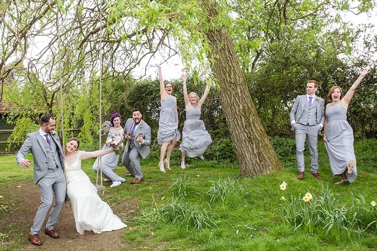 The bridal party having fun