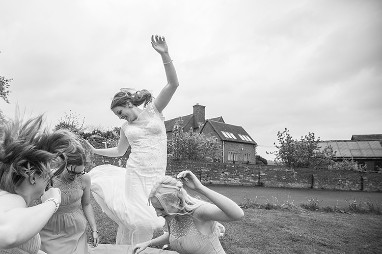 Bride and bridesmaids on a trampoline