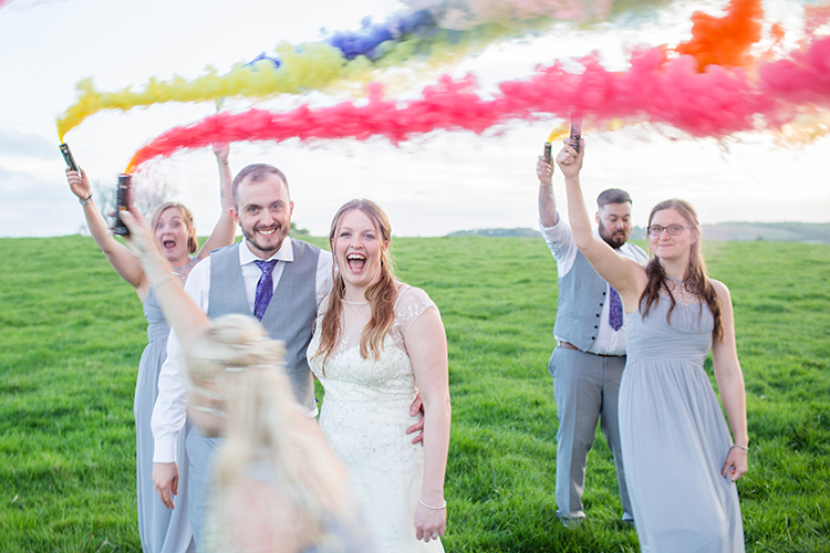 bridal party with smoke bombs