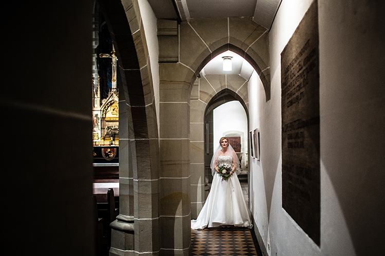 bride posing in church