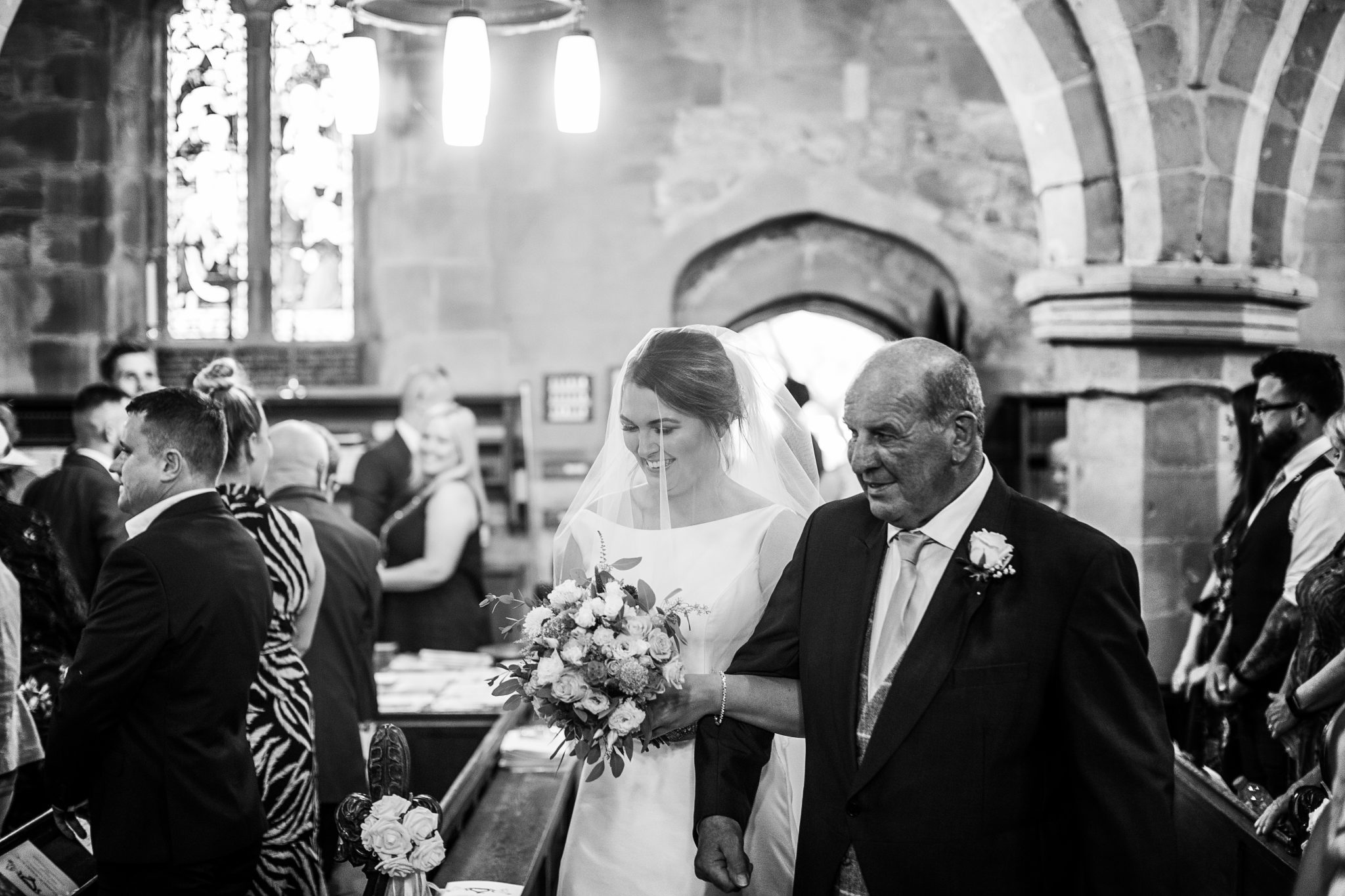 Bride and dad walking up the isle