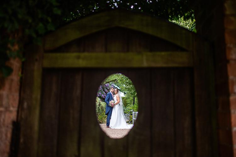 Bride and Groom through door