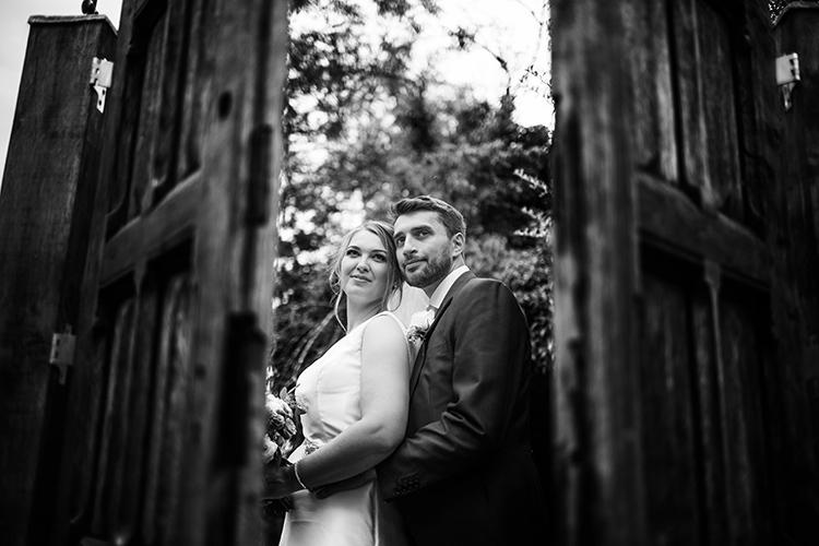Bride and Groom through door.