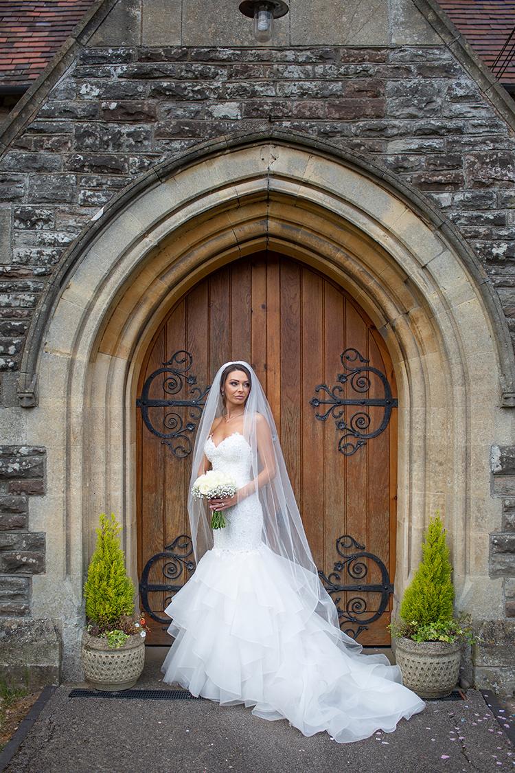 Bride in church door way.