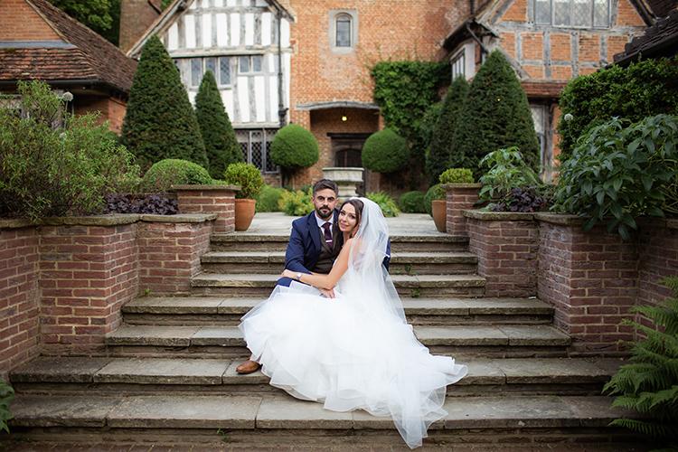 Bride and Groom on steps.