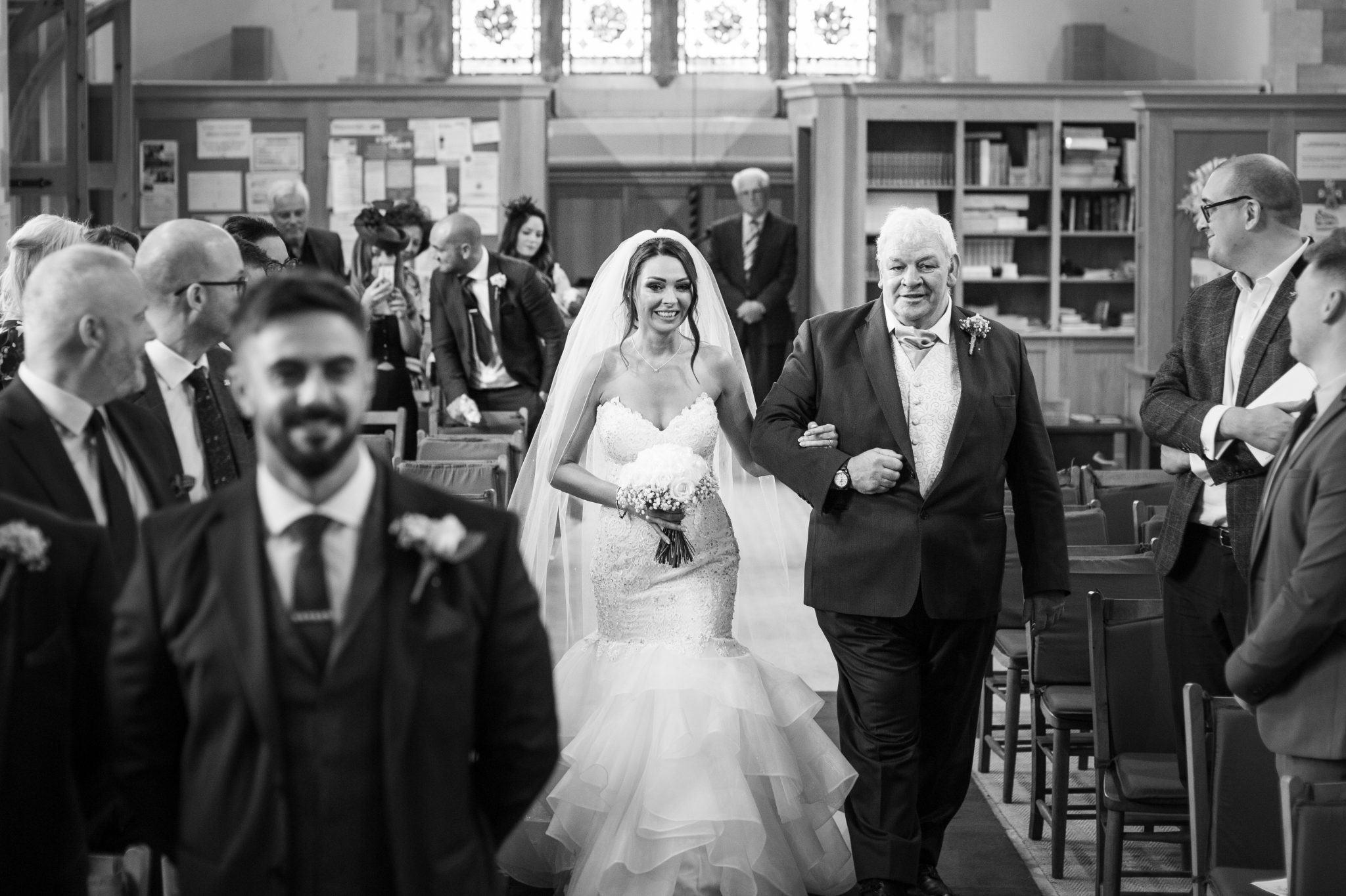Bride and dad walking up the isle.