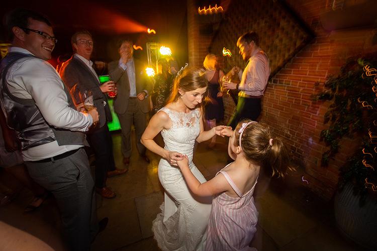 Bride dancing with flower girl