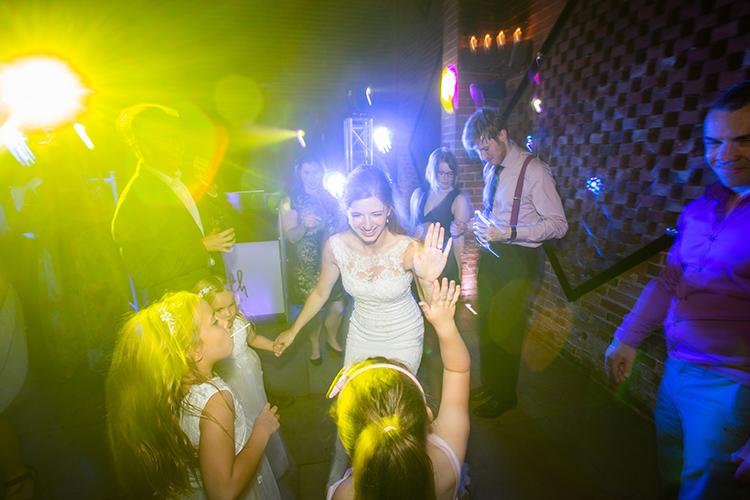 Bride dancing with guests.