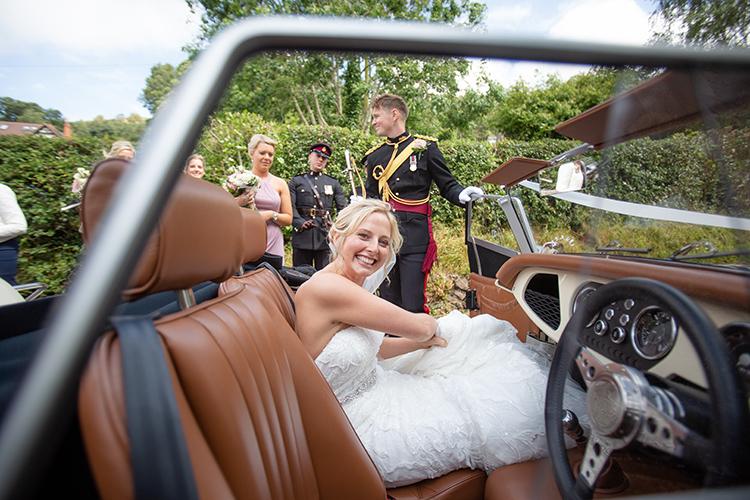 Bride getting the wedding car