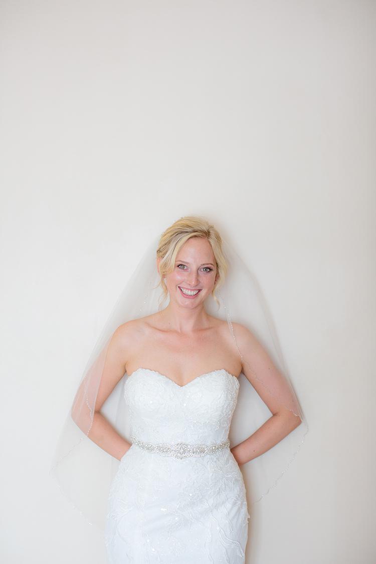 Bride posing on wall