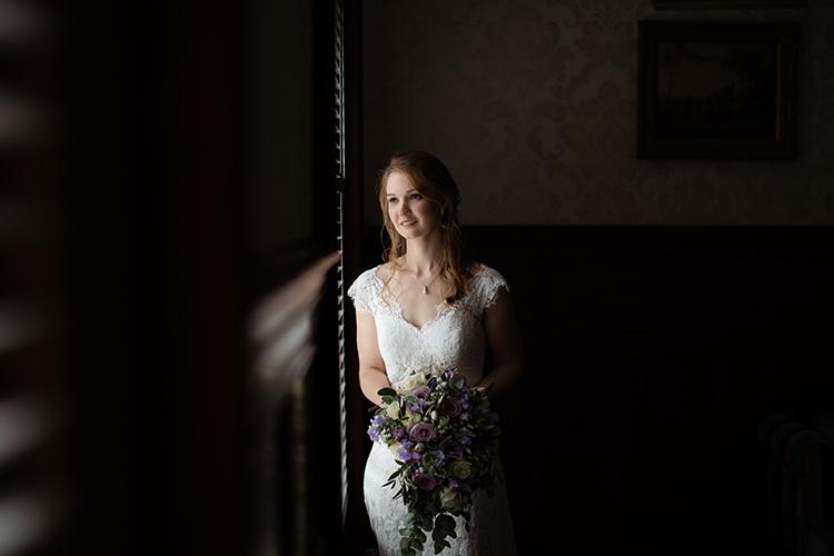 Bride by window.