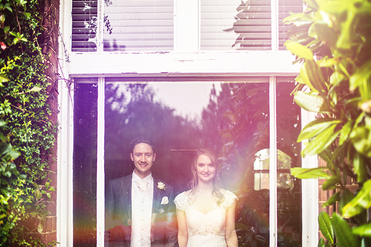 Bride and Groom by window