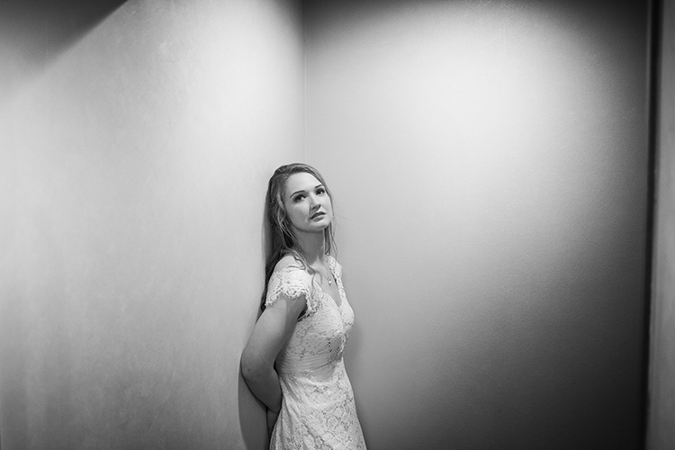 Bride against wall.