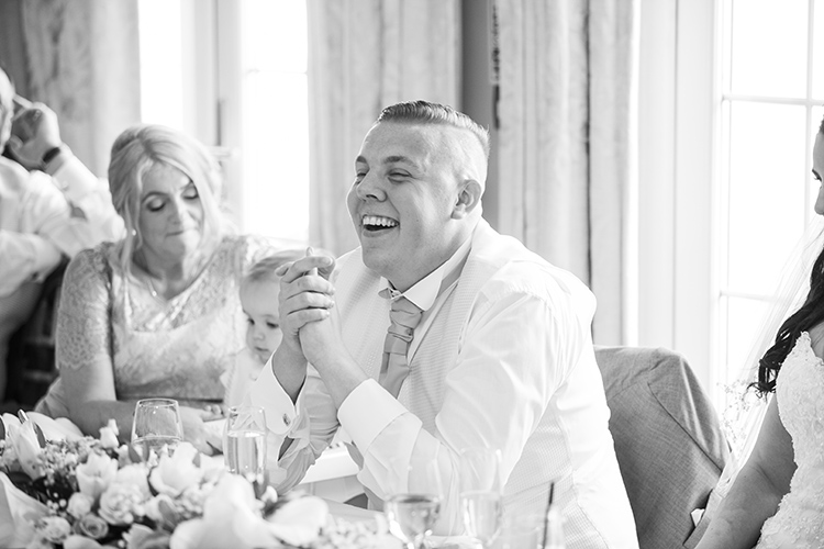 Groom laughing at Speech.