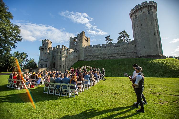 Outdoor wedding ceremony at Warwick Castle